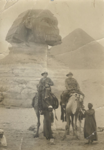 Walter (left) on a camel in Egypt. This photo was sent as a postcard to his brother, William.  Reproduced with permission RJ Jarrad.